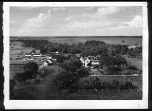 [Aerial photograph of the George Ranch house and ranch site surrounded by trees]