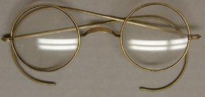 Primary view of object titled '[Small, round gold wire eyeglasses]'.
