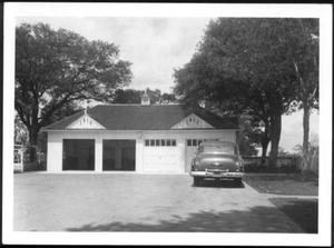 Primary view of object titled '[A car parked in front of George Ranch house garage]'.