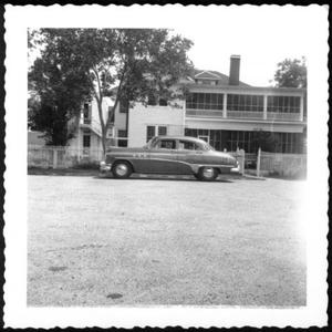 Primary view of object titled '[The George Ranch house with an automobile parked in the driveway]'.