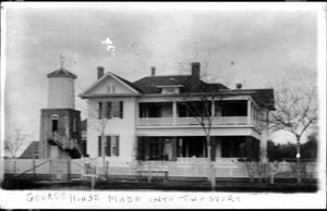 Primary view of object titled '[The George Ranch house and cistern house]'.
