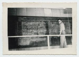 Primary view of object titled '[Instructor at Chalkboard]'.