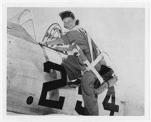 Primary view of object titled '[Hazel Pracht Climbing into Plane]'.