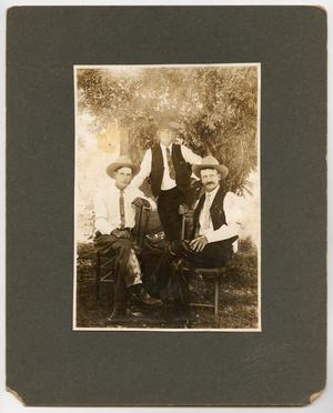 [Photograph of Three Men Outdoors]