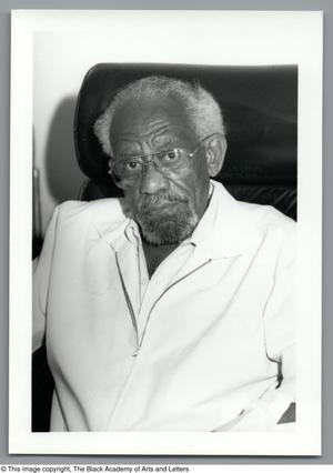 Black and white close up photograph of George Gamble, wearing a white coat.