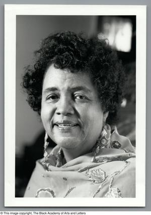 Black and white close up photograph of Dr. Mamie McKnight, wearing a floral wrap around her shoulders.
