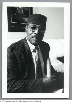 Black and white photograph of Minister Isaiah Karriem seated.