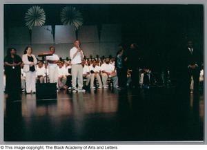 Primary view of object titled '[Christmas/Kwanzaa Concert Photograph UNTA_AR0797-136-08-12]'.