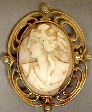 Primary view of object titled '[Pale pink cameo surrounded by gold]'.
