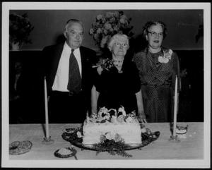 Primary view of object titled '[Babe Leake, Neely Jones Leake and his wife May, at Babe's 90th birthday party]'.