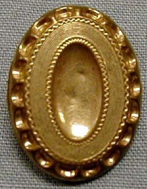 Primary view of object titled '[Oval shaped brass button with depression in center]'.