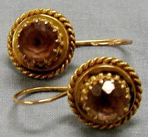 Primary view of object titled '[Pair of gold earrings]'.