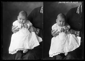 Primary view of object titled '[Child Sitting on Woman's Lap]'.