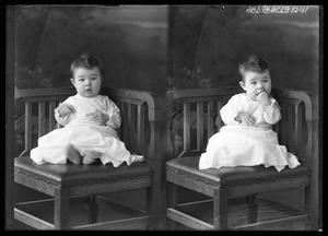 Primary view of object titled '[Child Sitting in Corner of Chair]'.