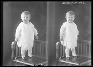 Primary view of object titled '[Child Standing in Corner of Chair]'.