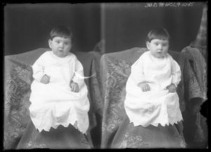 Primary view of object titled '[Infant on Covered Chair]'.
