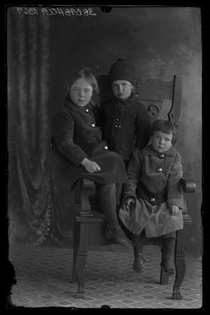 Primary view of object titled '[Portrait Children in Chair]'.