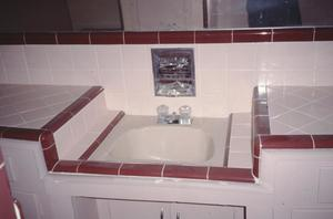 Primary view of object titled '[Connelly-Yerwood House, (sink in pink art deco bathroom tile)]'.