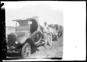 Primary view of object titled '[Portrait of Three Men Beside Automobiles]'.