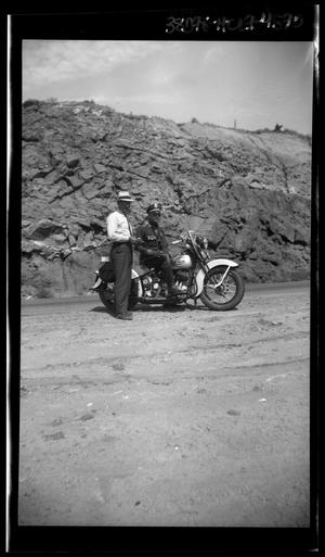 Primary view of object titled '[Portrait of Two Men and a Motorcycle]'.