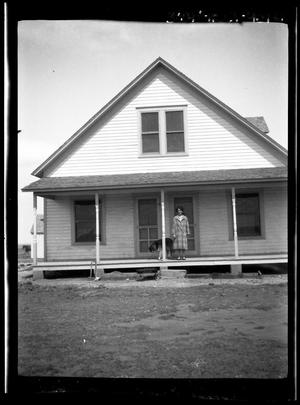 Primary view of object titled '[Portrait of a Woman and a Dog on a Porch]'.