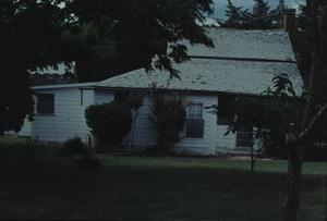 "Primary view of object titled '[J. R. Cannon House, (south side- shows ""smoke house"" to left)]'."