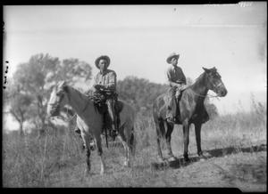 Primary view of object titled '[Photograph of Two Men and Two Horses]'.