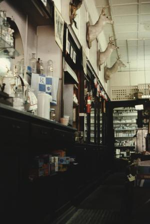 Primary view of object titled '[Highland Ave Pharmacy, (interior, south wall)]'.