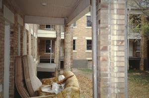 Primary view of object titled '[Markeen Apartments, (looking E from back porch of Daggett St Bldg toward rear of St Louis Bldg)]'.
