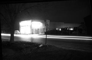 Primary view of object titled '[Carl McCaslin Lumber Company at Night]'.