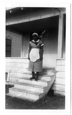 Primary view of object titled '[Unidentified Woman on Steps of Freeport Rectory]'.
