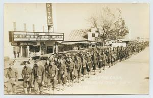 Primary view of object titled '[Postcard of Soldiers Marching by the Capitol Theater]'.