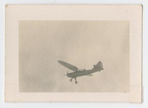 Primary view of object titled '[Photograph of a Douglas 0-43A Airplane Above Camp Hulen]'.
