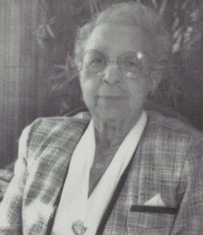 Black and white photograph of Jimmie Tyler Brashear wearing a plaid blazer and white top.