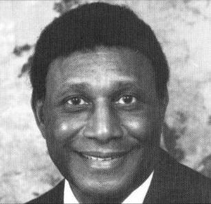 Black and white close up photograph of Joe Kirven.