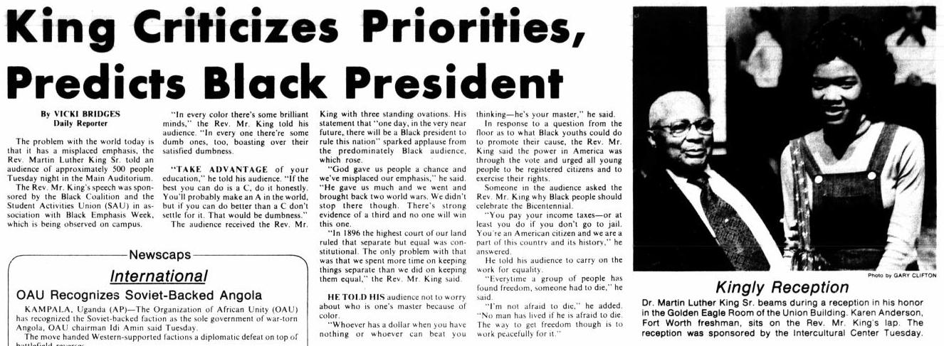 This is a news article with the title at the top in bold. Followed by four columns of text. Next to it on the right is a photo of an African American woman and man. It is titled Kingly Reception with more text under it.